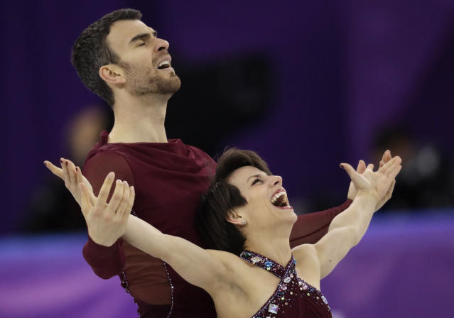 Meagan Duhamel and Eric Radford of Canada react after their performance in the pairs free skate figure skating final in the Gangneung Ice Arena at the 2018 Winter Olympics in Gangneung, South Korea, Thursday, Feb. 15, 2018. (AP Photo/Bernat Armangue)