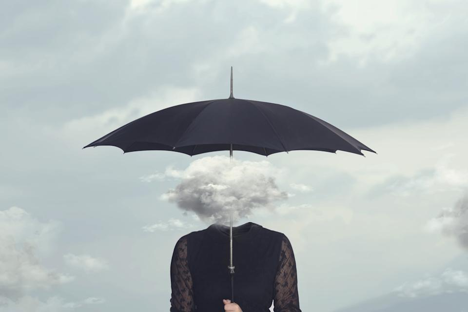 elegant woman with cloud head sheltering herself from the rain with umbrella