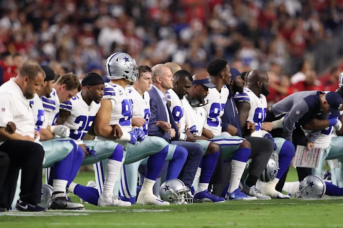 Members of the Dallas Cowboys kneel prior to a game in 2017. (Photo by Christian Petersen/Getty Images)