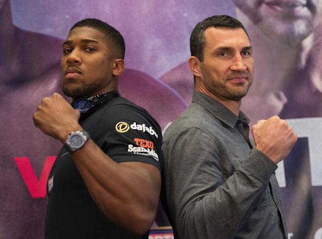 Anthony Joshua (left) will defend his heavyweight world title against Wladimir Klitschko at London's Wembley Stadium on April 29 (AFP Photo/DON EMMERT)
