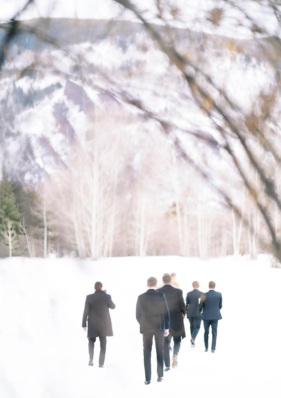 Some adventurous young men walking into the snowy field where our ceremony was to be held.