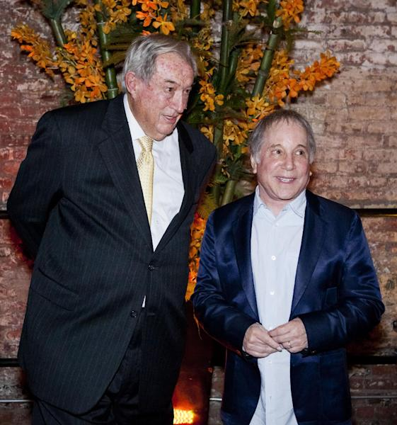 """In this May 2, 2012 photo provided by the Turkana Basin Institute, paleoanthropologist Richard Leakey, left, attends a fundraiser for the Turkana Basin Institute with his friend Paul Simon, who was the guest performer in New York. The Kenyan-born scientist, who serves as a professor at Stony Brook University on New York's Long Island, just spent a month in New York raising funds for his Turkana Basin Institute in Kenya. Leakey predicts skepticism over evolution will soon be history sometime in the next 15 to 30 years. """"If you get to the stage where you can persuade people on the evidence, that it's solid, that we are all African, that color is superficial, that stages of development of culture are all interactive,"""" Leakey says, """"then I think we have a chance of a world that will respond better to global challenges."""" (AP Photo/Ralph R. Smith)"""
