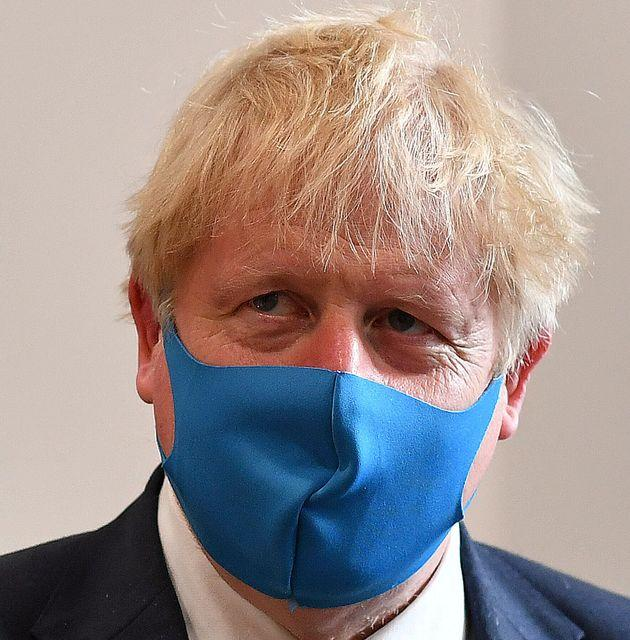 Boris Johnson, wearing a face mask, visits the headquarters of the London Ambulance Service NHS Trust in London