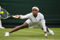 Coco Gauff of the US slips on the grass as she plays a return to Britain's Francesca Jones during the women's singles first round match on day two of the Wimbledon Tennis Championships in London, Tuesday June 29, 2021. (AP Photo/Alastair Grant)