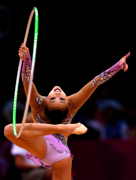 LONDON, ENGLAND - AUGUST 11:  Yeon Jae Son competes during the Individual All-Around Rhythmic Gymnastics final on Day 15 of the London 2012 Olympics Games at Wembley Arena on August 11, 2012 in London, England.  (Photo by Jamie Squire/Getty Images)
