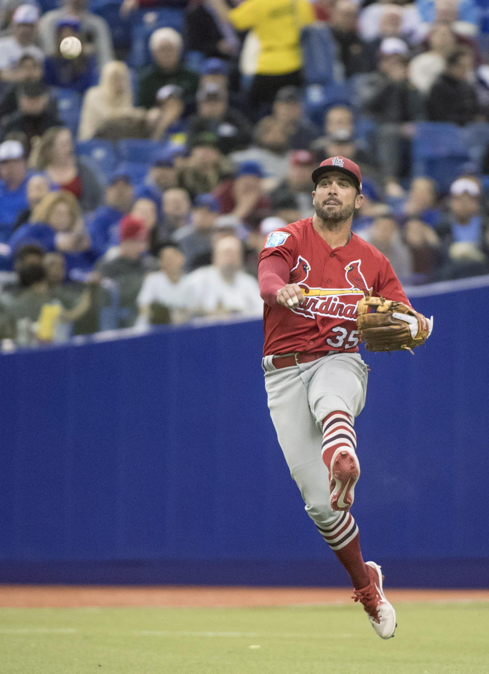 St. Louis Cardinals shortstop Greg Garcia throws out Toronto Blue Jays' Teoscar Hernandez at first during the seventh inning of a baseball exhibition game Tuesday, March 27, 2018, in Montreal. (Paul Chiasson/The Canadian Press via AP)