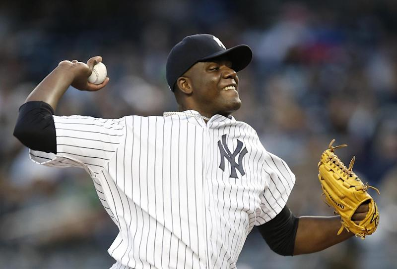 New York Yankees starting pitcher Michael Pineda delivers in the first inning of a baseball game against the Boston Red Sox at Yankee Stadium in New York, Thursday, April 10, 2014. (AP Photo/Kathy Willens)