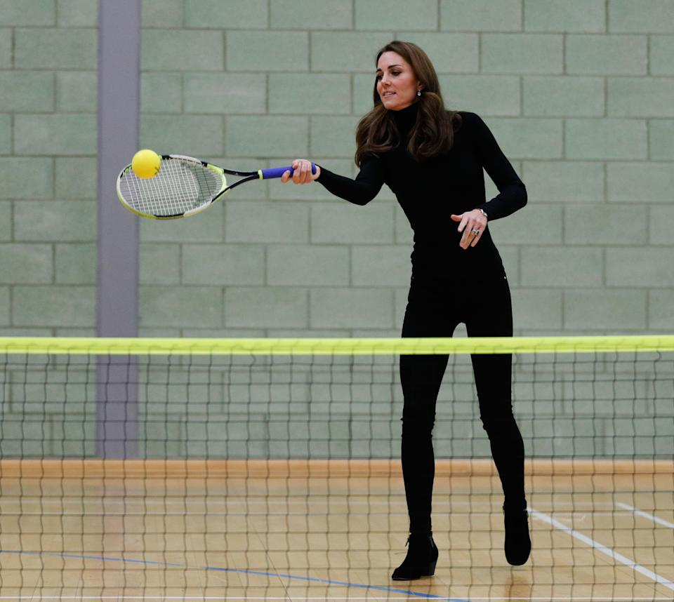 Britain's Catherine, Duchess of Cambridge, plays tennis as she joins a session with a group during a visit the Coach Core Essex apprenticeship scheme at Basildon Sporting Village in Basildon, southeast England, on October 30, 2018. - The Duke and Duchess of Cambridge visited Coach Core Essex to meet new apprentices, hear from graduates, and learn how the scheme in Essex is engaging a diverse local community with sport. The Duke and Duchess met with new Coach Core apprentices and joined in with their coaching sessions, including tennis and indoor athletics. (Photo by Adrian DENNIS / various sources / AFP)        (Photo credit should read ADRIAN DENNIS/AFP/Getty Images)