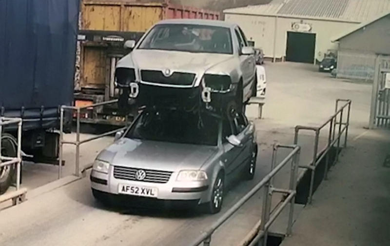 Glyndwr Wyn Richards, 51, strapped the motor to the top of a different one to transport it on an industrial estate (Picture: SWNS)