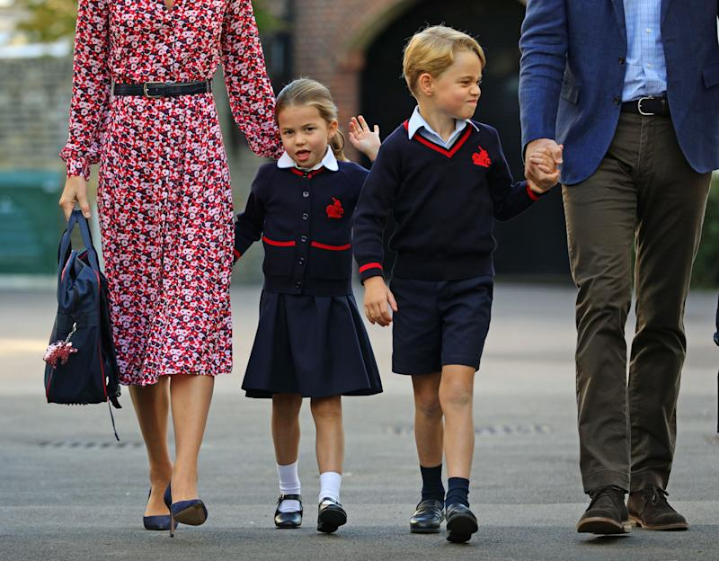 TOPSHOT - Britain's Princess Charlotte of Cambridge, with her brother, Britain's Prince George of Cambridge, arrives for her first day of school at Thomas's Battersea in London on September 5, 2019. (Photo by Aaron Chown / POOL / AFP) (Photo by AARON CHOWN/POOL/AFP via Getty Images)