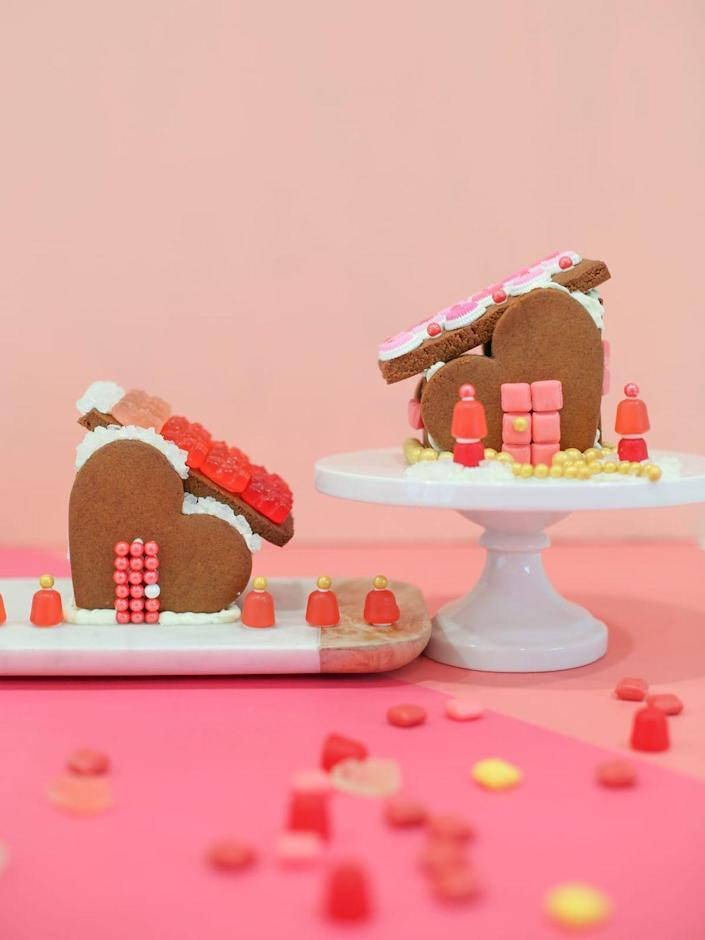 """<p>Break out the gingerbread for another holiday this year with these adorable, heart-shaped candy homes. </p><p><strong>Get the tutorial at <a href=""""https://lovelyindeed.com/gingerbread-heart-houses-for-valentines-day/"""" rel=""""nofollow noopener"""" target=""""_blank"""" data-ylk=""""slk:Lovely Indeed"""" class=""""link rapid-noclick-resp"""">Lovely Indeed</a>.</strong></p><p><strong><a class=""""link rapid-noclick-resp"""" href=""""https://www.amazon.com/FASAKA-Valentines-Cookie-Cutters-Color/dp/B07ZNTKLMX/?tag=syn-yahoo-20&ascsubtag=%5Bartid%7C10050.g.1584%5Bsrc%7Cyahoo-us"""" rel=""""nofollow noopener"""" target=""""_blank"""" data-ylk=""""slk:SHOP HEART COOKIE CUTTERS"""">SHOP HEART COOKIE CUTTERS</a><br></strong></p>"""