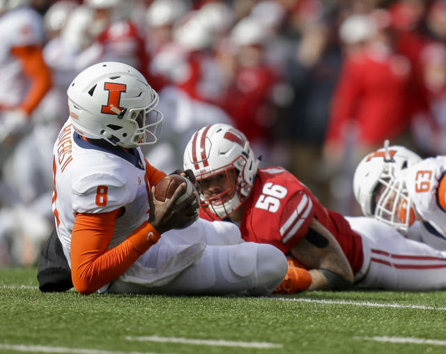 FILE - In this Oct. 20, 2018, file photo, Wisconsin linebacker Zack Baun (56) sacks Illinois quarterback M.J. Rivers (8) during the second half of an NCAA college football game in Madison, Wis. Baun is a possible pick in the NFL Draft which runs Thursday, April 23, 2020, thru Saturday, April 25. (AP Photo/Andy Manis, File)