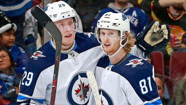 Laine, Connor miss first day of Jets training camp