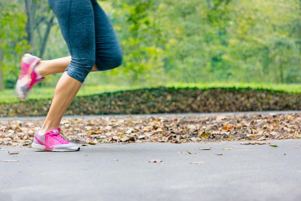 Close up of woman runner's legs running in park, training exercise. Little motion blur present. Canon 5D MK III