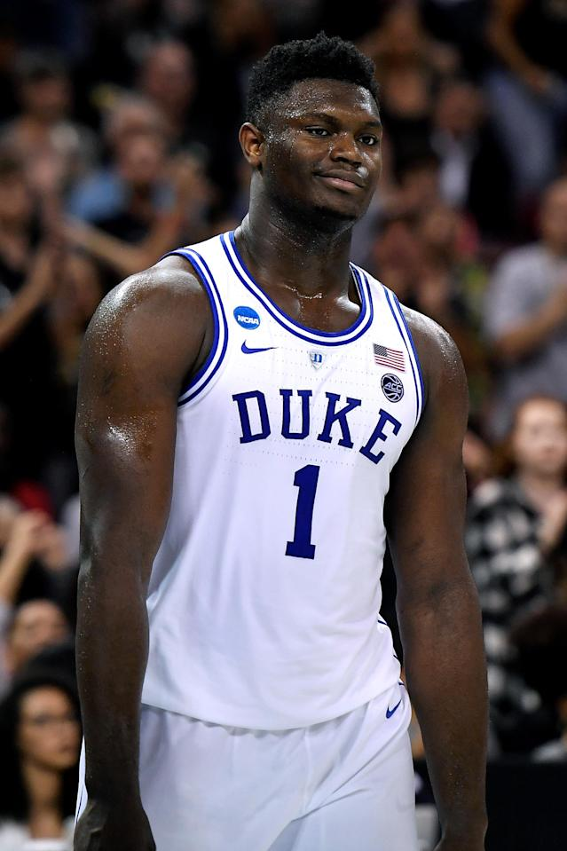 <p>Zion Williamson #1 of the Duke Blue Devils reacts following a play in the first half against the Central Florida Knights during the second round of the 2019 NCAA Men's Basketball Tournament at Colonial Life Arena on March 24, 2019 in Columbia, South Carolina. (Photo by Lance King/Getty Images) </p>