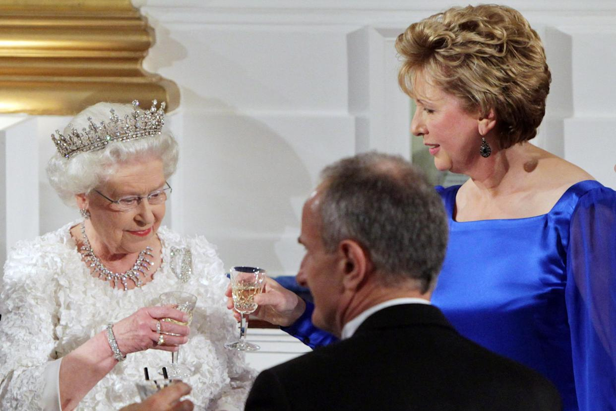 Britain's Queen Elizabeth II after giving a speech at Dublin Castle toasts with Irish President Mary McAleese (right) during a State Dinner on the second day of her State Visit to Ireland.   (Photo by John Stillwell/PA Images via Getty Images)