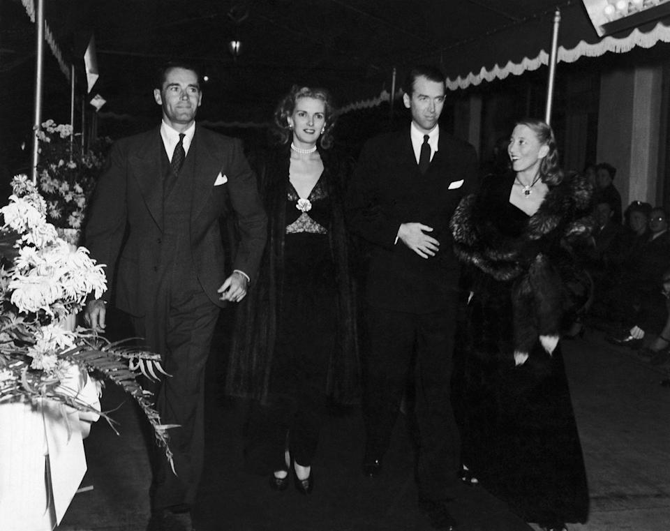 <p>Henry Fonda, Anita Colby, James Stewart, and Frances Fonda make their way down the covered red carpet at the 1945 premiere of Alfred Hitchcock's <em>Spellbound</em>. </p>