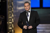 """FILE - Comedian-actor Norm Macdonald appears onstage at The 2012 Comedy Awards in New York on April 28, 2012. Macdonald, a comedian and former cast member on """"Saturday Night Live,"""" died Tuesday, Sept. 14, 2021, after a nine-year battle with cancer that he kept private, according to Brillstein Entertainment Partners, his management firm in Los Angeles. He was 61. (AP Photo/Charles Sykes, File)"""