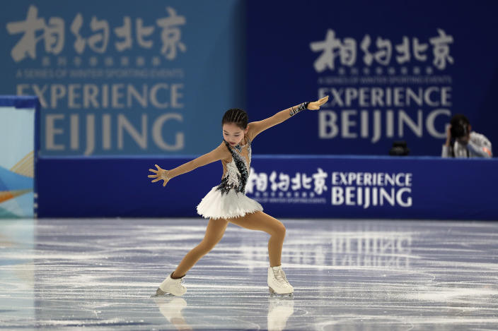 Chinese figure skater Xu Jingyu performs her women's single skating short programme during a test event for the 2022 Beijing Winter Olympics at the Capital Indoor Stadium in Beijing, Sunday, April 4, 2021. The organizers of the 2022 Beijing Winter Olympics has started 10 days of testing for several sport events in five different indoor venues from April 1-10, becomes the first city to hold both the Winter and Summer Olympics. (AP Photo/Andy Wong)
