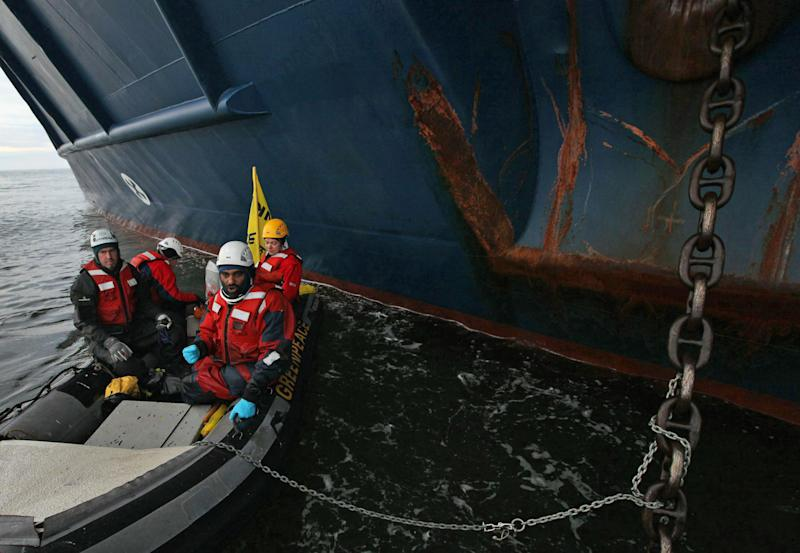 This image made available by environmental organization Greenpeace shows Greenpeace activists chained to the anchor chain of the Anna Akhmatova, the vessel which was carrying Gazprom's workers to the Prirazlomnaya platform, in the Pechora Sea about 620 miles (1,000 kilometers) from the nearest port, Murmansk, a city on the extreme northwestern edge of the Russian mainland, Monday Aug. 27, 2012. Gazprom is pioneering Russia's oil drilling in the Arctic. The state-owned company installed the platform there last year and is preparing to drill the first well. Environmentalists have warned that drilling in the Russian Arctic could have disastrous consequences because of a lack of technology to deal with a possible spill in this remote region. (AP Photo/Denis Sinyakov/Greenpeace, HO)