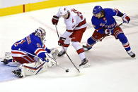 New York Rangers' goaltender Igor Shesterkin (31) stops Carolina Hurricanes' Sebastian Aho (20) as Rangers' Artemi Panarin (10) defends during second period NHL Eastern Conference Stanley Cup playoff action in Toronto on Tuesday, Aug. 4, 2020. (Frank Gunn/The Canadian Press via AP)