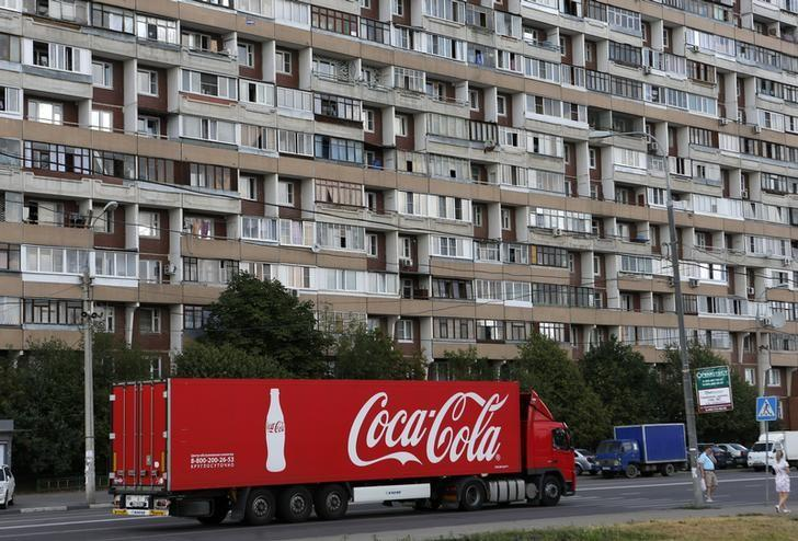A truck transports bottles from the Coca-Cola company on the outskirts of Moscow