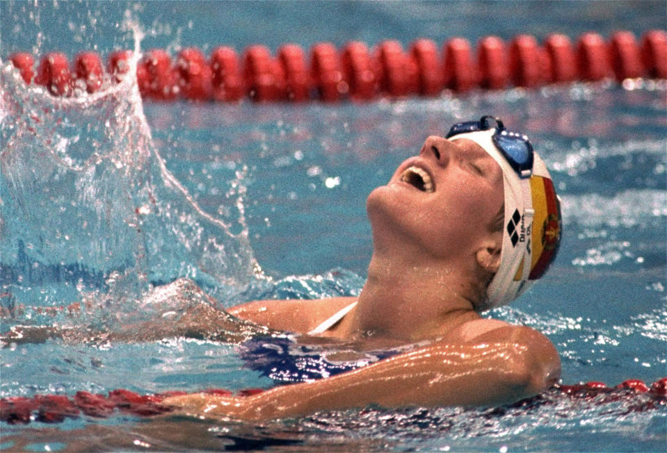 FILE - In this Sept. 19, 1988, file photo, Kristin Otto, of East Germany, exults after winning the gold medal in the women's 100-meter freestyle in the Summer Olympics in Seoul, South Korea (AP Photo/Eric Risberg, File)