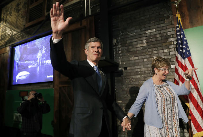 Fred Hubbell waves while holding hands with his wife, Charlotte, during a rally in Des Moines, Iowa, June 5, 2018. (Photo: Charlie Neibergall/AP)