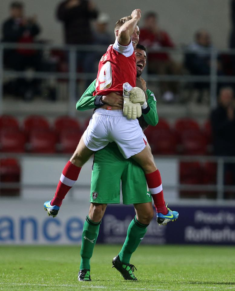 Rotherham's David Noble and Scott Shearer(bottom) celebrate winning the Capital One Cup, First Round match at the New York Stadium, Rotherham.