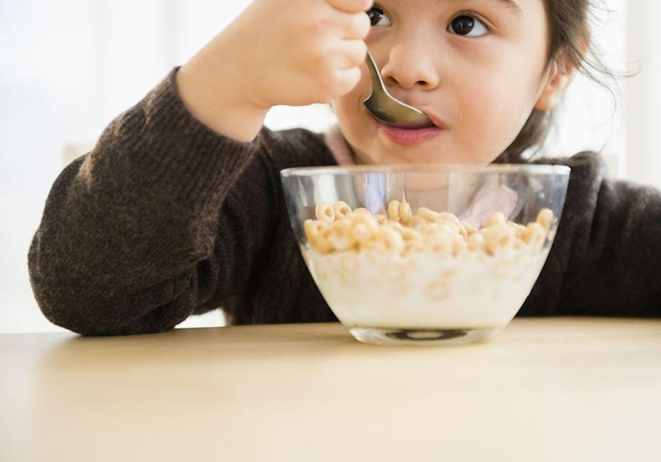 """<p>Many cereals are also marketed towards kids, with fun cartoon characters on the box and unique shapes. But check the nutritional label for the sugar content before purchasing one. A <a href=""""https://www.researchgate.net/publication/49675269_Effects_of_Serving_High-Sugar_Cereals_on_Children's_Breakfast-Eating_Behavior"""" rel=""""nofollow noopener"""" target=""""_blank"""" data-ylk=""""slk:2011 study"""" class=""""link rapid-noclick-resp"""">2011 study</a> found that high-sugar cereals increase a child's total sugar consumption and reduces the overall nutritional quality of their breakfast. </p><p>That same study also found that kids <em>will</em> eat low-sugar options and sweeten their cereal with fruit when given the chance, meaning that's a great option. Try that instead next time.</p>"""