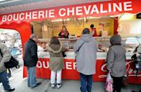 """Customers queue at a horsemeat butcher in Anzin, northern France, on February 22, 2013. Three carcasses containing phenylbutazone """"probably"""" made it to consumers, but there was """"no health risk"""" since the traces of the drug found in the meat were """"extremely weak,"""" said Agriculture Minister Stephane Le Foll"""