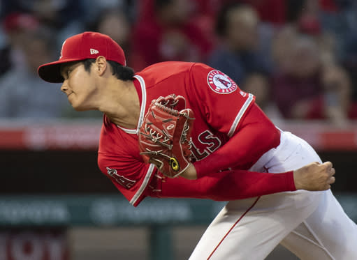 FLE - In this June 6, 2018 file photo Los Angeles Angels starting pitcher Shohei Ohtani watches a pitch during the third inning of a baseball game against the Kansas City Royals in Anaheim, Calif. Ohtani will be re-evaluated within the next three weeks to gauge progress in his recovery from a sprained ligament in his right elbow. Angels manager Mike Scioscia announced the slight adjustment to Ohtanis timeline Monday, June 18, 2018 before his club opened an interleague series against Arizona. (AP Photo/Kyusung Gong, file)
