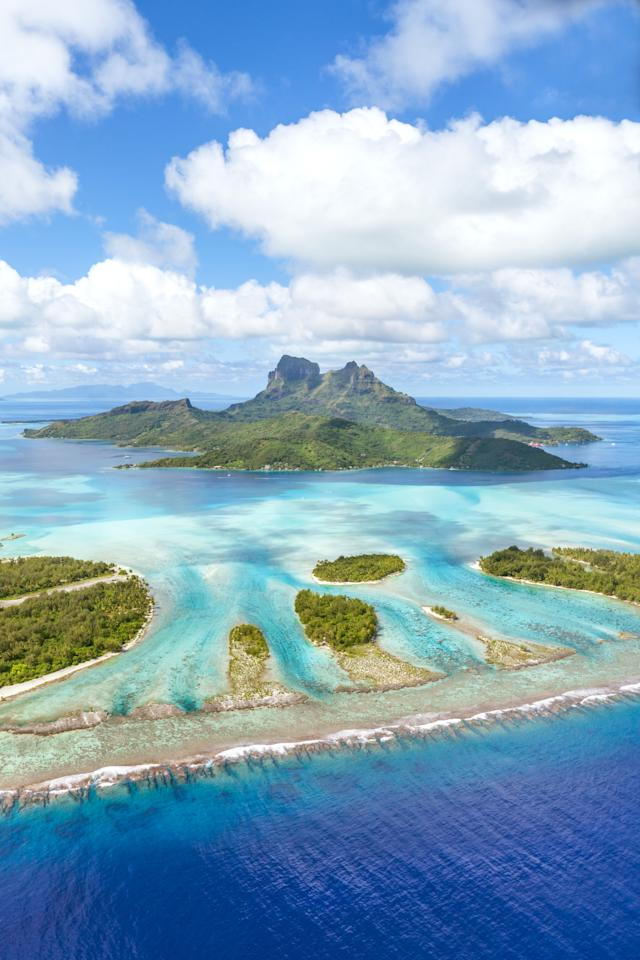 <p>With turquoise lagoons, coral reefs and overwater bungalows, this small island in the South Pacific is basically heaven on Earth.</p>