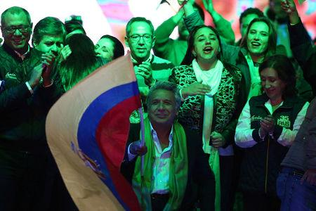 Ecuadorean presidential candidate Lenin Moreno and supporters wait for the results of the national election in a hotel in Quito