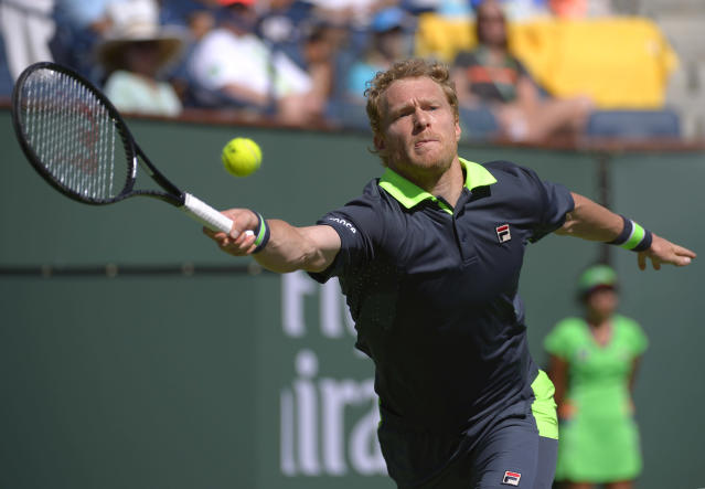 Dmitry Tursunov, of Russia, hits to Roger Federer, of Switzerland, during a third round match at the BNP Paribas Open tennis tournament, Monday, March 10, 2014, in Indian Wells, Calif. (AP Photo/Mark J. Terrill)