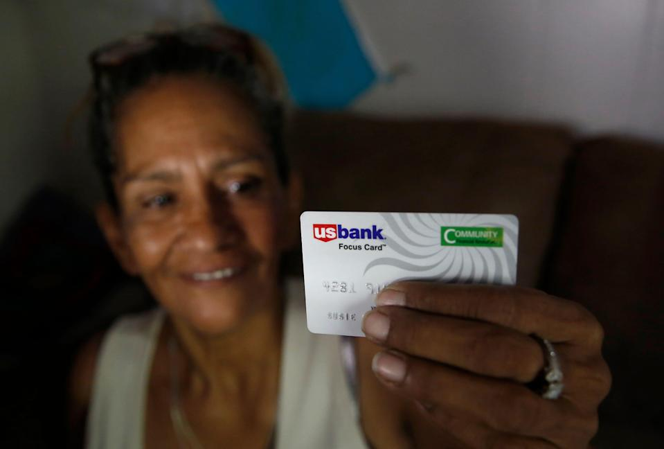 Susie Garza received a monthly debit card through a trial program in Stockton, Calif.