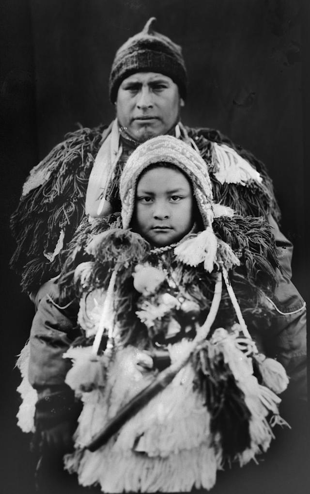 <p>Aldo Machaca, 33, and his son Brandon, 6, pose for a portrait in the Sinakara Valley, in Peru's Cuzco region, during the Qoyllur Rit'i festival, translated from the Quechua language as Snow Star. Aldo and Brandon dance as part of the Quispicanchis nation. (Photo: Rodrigo Abd/AP) </p>