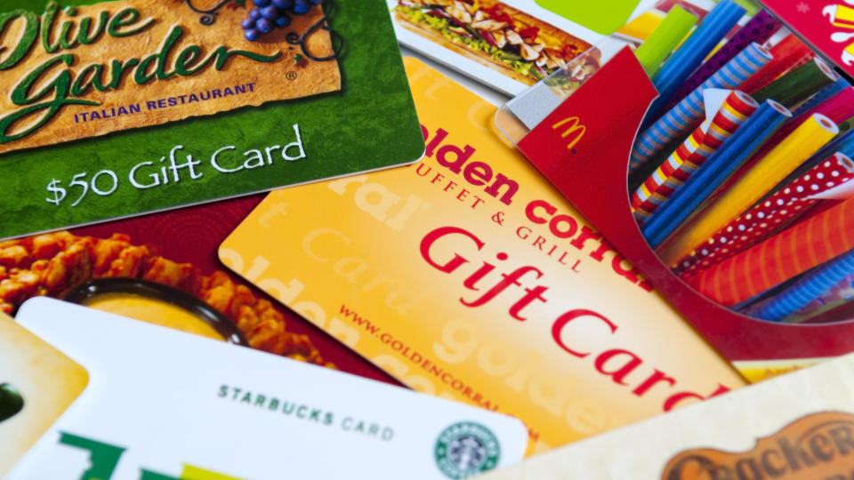Indialantic, FL, USA - July 29, 2011: A variety of restaurant gift cards on a white background, including Cracker Barrel, McDonald's, Olive Garden, Golden Corral, Subway, Outback, and Starbucks.