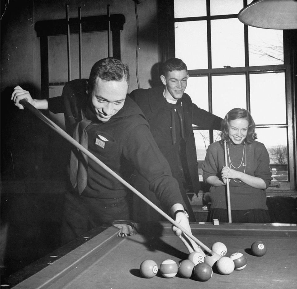 <p>Students at the University of Wisconsin play pool in their free time. </p>