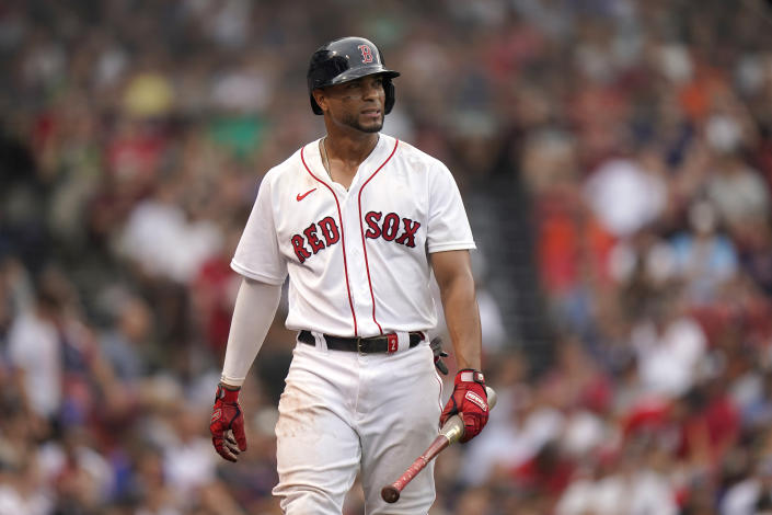 Boston Red Sox's Xander Bogaerts reacts after he struck out looking in the ninth inning of a baseball game against the Philadelphia Phillies, Sunday, July 11, 2021, in Boston. (AP Photo/Steven Senne)