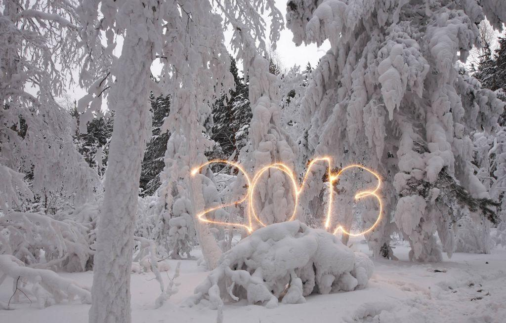 A reveller writes the number 2013 with sparklers ahead of New Year's Day at an air temperature of about -25 degrees Celsius (-13 F) in a forest outside Russia's Siberian city of Krasnoyarsk December 31, 2012. Picture taken with long exposure on December 31, 2012.