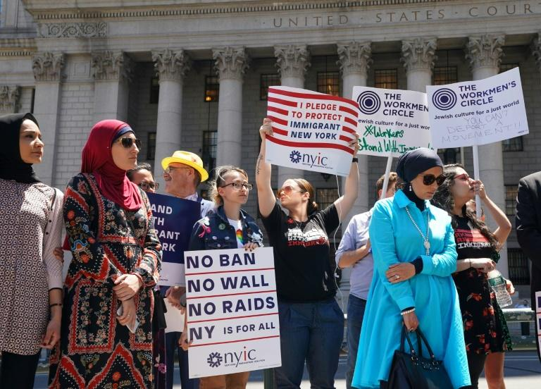 Members of the New York Immigration Coalition hold a news conference in Foley Square, to talk about the US Supreme Court decision to uphold US President Donald Trump's Muslim ban, in June 2018