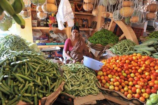 A vendor waits for customers at a vegetable market in Hyderabad