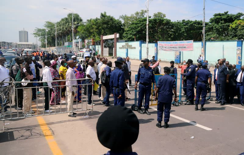 FILE PHOTO: Congolese police officers control civilians during a total lockdown amid concerns about the spread of the coronavirus in Gombe commune of Kinshasa