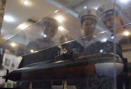usnFile picture of sailors looking at a model of a submarine scheduled for delivery to Vietnam in 2013, in Hai Phong