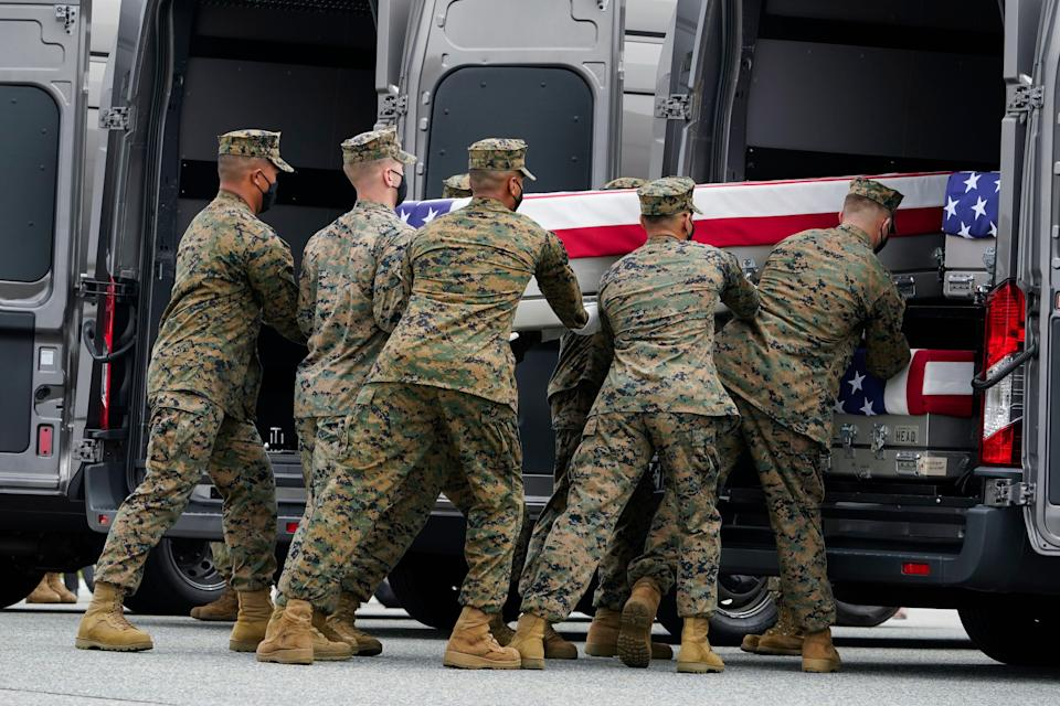A Marine Corps carry team loads a transfer case containing the remains of Marine Corps Cpl. Daegan William-Tyeler Page, 23, of Omaha, Neb., at Dover Air Force Base.