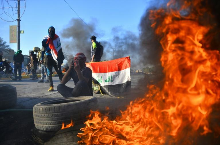 Iraqi demonstrators have blocked roads to protest against the country being used as an arena for conflict between the United States and Iran (AFP Photo/Haidar HAMDANI)