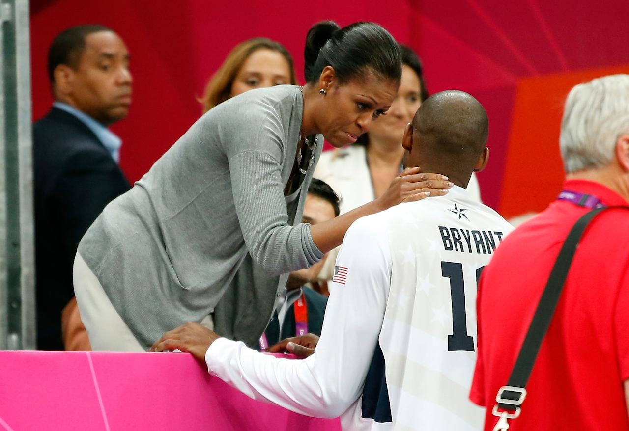 LONDON, ENGLAND - JULY 29:  First Lady Michelle Obama talks with Kobe Bryant #10 after their Men's Basketball Game between the United States and France on Day 2 of the London 2012 Olympic Games at the Basketball Arena on July 29, 2012 in London, England.  (Photo by Jamie Squire/Getty Images)