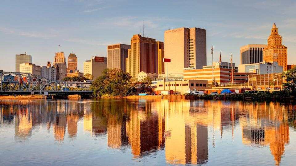 Downtown Newark skyline refection on the banks of the Passaic River.