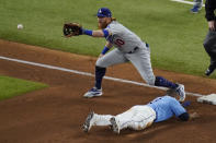 Tampa Bay Rays' Manuel Margot is safe at third past Los Angeles Dodgers third baseman Justin Turner after a Los Angeles Dodgers fielding error by Chris Taylor during the fourth inning in Game 5 of the baseball World Series Sunday, Oct. 25, 2020, in Arlington, Texas. (AP Photo/Sue Ogrocki)